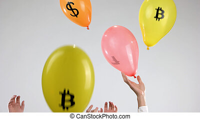 Colored balloons with currency signs.
