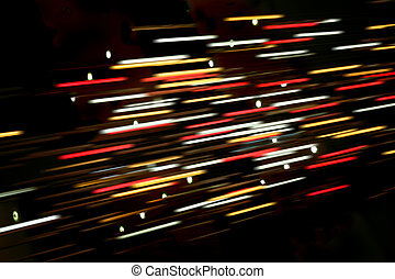 Colored blurred lines of light on dark background