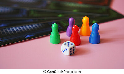 Colored board game figures with dice