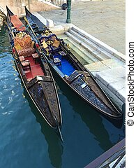Colored boats in Venice city on water