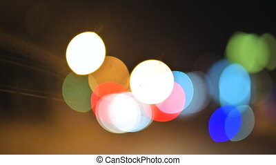 Colored bokeh lights in the night city. moving circles of...
