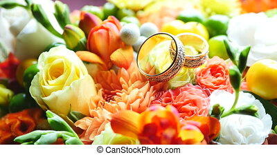 colored bouquet close up of wedding rings