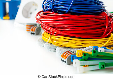 colored bundles of wires with electric terminals on a white background