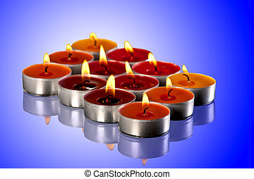colored candles on blue background