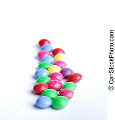 Colored candys - Sweet candy with different colours at white...