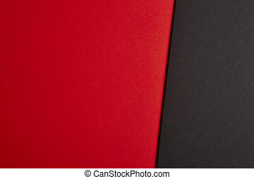 Colored cardboards background in red black tone. Copy space