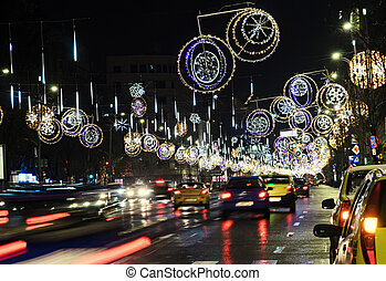 Colored Christmas lights and ornaments, stars and globes in downtown of  Bucharest, Romania night time