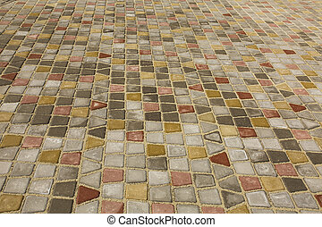 Colored cobblestones pavement at the city