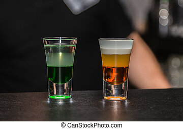 Colored cocktail on the bar in the nightclub