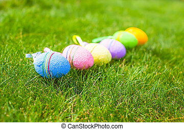 Colored colorful easter eggs in the grass