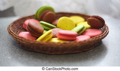 colored cookies falls in the wicker plate