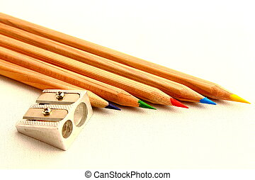 colored crayons and sharpener