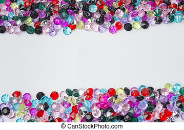 Colored decorative stones on a white background.