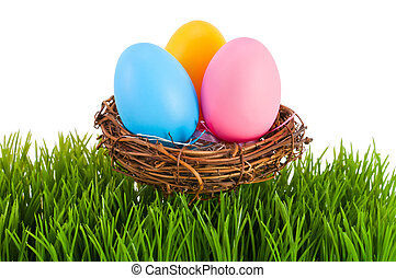 Colored Easter eggs in a nest.
