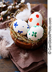 Colored Easter eggs in a nest