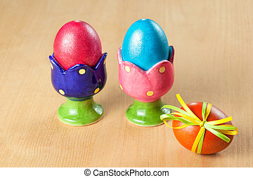 Colored easter eggs in egg cups