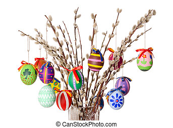 Colored easter eggs on willow bouquet over white