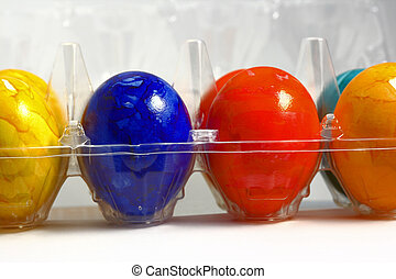 colored eggs on the white background