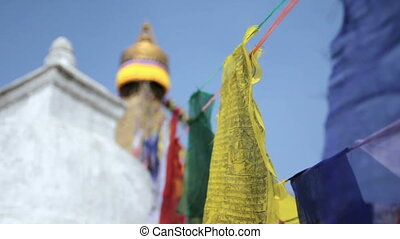 Colored flags fly near Boudha Bouddhanath or Baudhanath...
