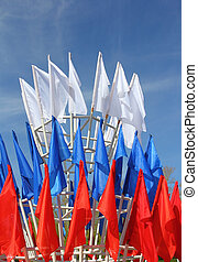 colored flags on a blue sky background
