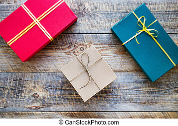 Colored gift boxes on wooden background