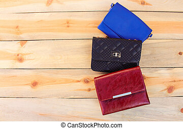 colored handbags on wooden background