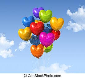 colored heart shape balloons on a blue sky