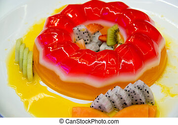 jelly with mixed fresh fruit background