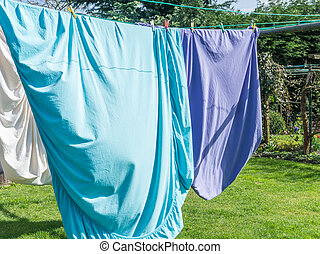 Colored laundry drying on a laundry line outside