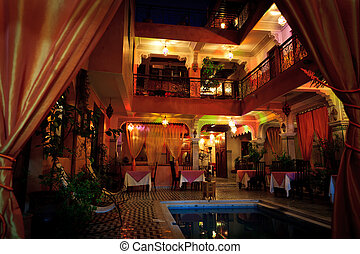 Marrakesh, Morocco: Colorful interior lights at night inside a riad in Marrakesh, Morocco.