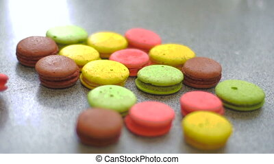 colored macaroon cookies falls on the table