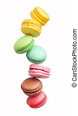colored macaroons on a white background