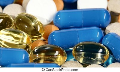 Colored medical pills, tablets and capsules, rotation, macro