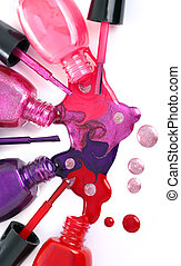 colored nail polish spilling from bottles - Image of...