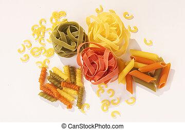 diferent colored Noodles on white Background - verschiedene farbige Nudeln auf weissem Hintergrund