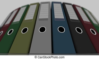 Colored office binders, low angle wide shot, shallow focus. 4K seamless loopable animation