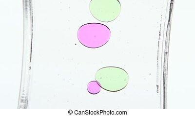 Colored oil. Time period. White. Close up