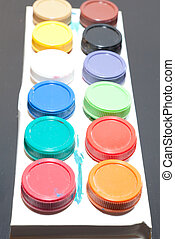 colored paint artist on gray background