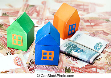 Colored paper houses on the background of Russian money