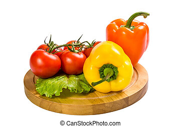 Colored paprika and tomatoes isolated