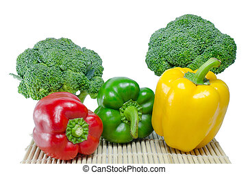 Colored paprika (pepper) and Broccoli on a white background