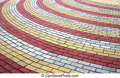 Colored pavement . - Junction of three different colored ...