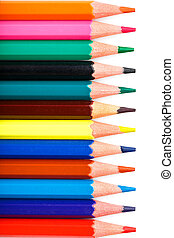 Colored pencils in a row on a white background, free space for text.