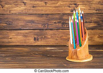 Colored pencils in a wooden stand