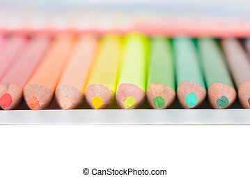 Colored pencils in box, shallow depth of field