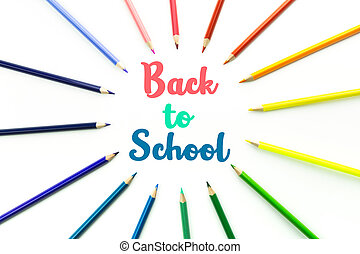 Colored pencils isolated on white background and text Back to School.