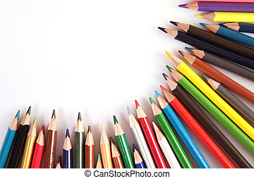 Colored pencils lie in a row