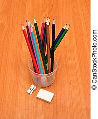 colored pencils, sharpener and eraser
