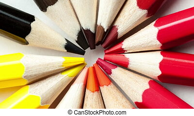 colored pencils spinning circle on a white background close-up