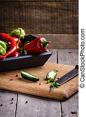 Colored pepper on cutting board.